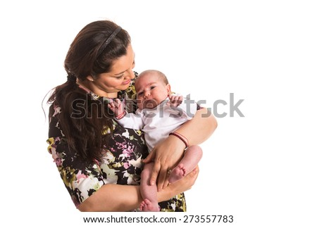 Mother caring newborn baby girl isolated on white background - stock photo
