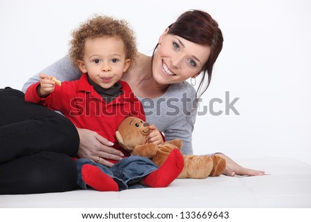 Mother, child and teddy bear - stock photo