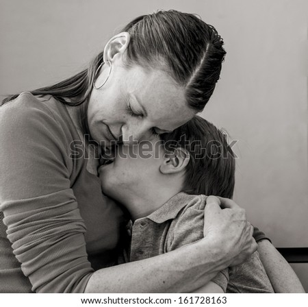 Mother comforting her crying 6 year-old son - stock photo