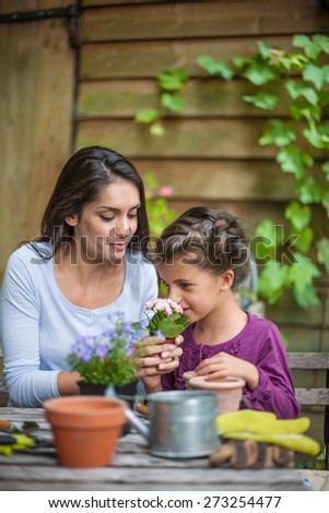Mother daughter special moment. Gardening discovering and teaching - stock photo