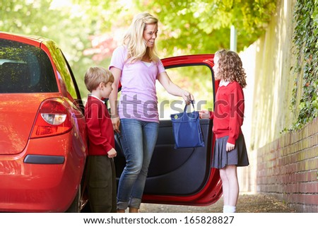 Mother Driving To School With Children - stock photo
