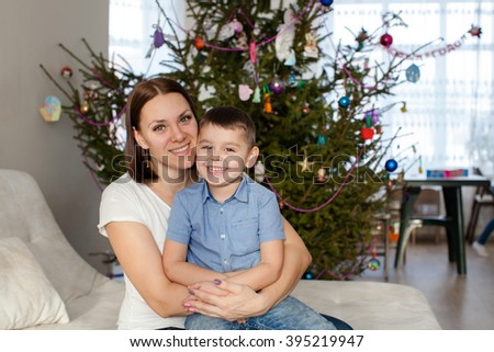 Mother embracing her happy son - stock photo