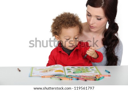 Mother encouraging creative toddler - stock photo