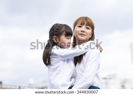 Mother entertain the children - stock photo