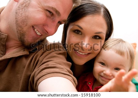 mother, father and baby girl together - stock photo