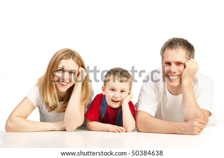 Mother, father and child lying on the floor - stock photo