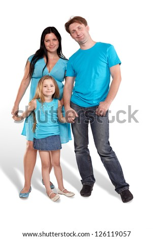 Mother, father and little daughter stand holding hands - stock photo