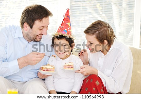 Mother father and little son at home - stock photo