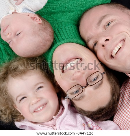 Mother, father and two daughters. Studio picture - stock photo
