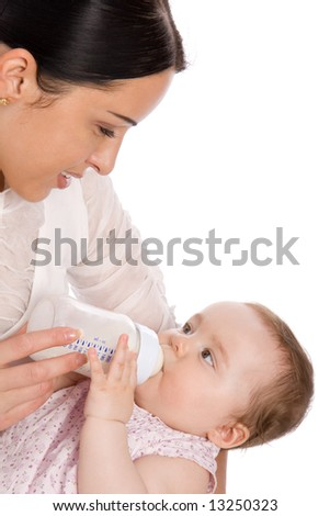 Mother feeding baby daughter isolated on white - stock photo
