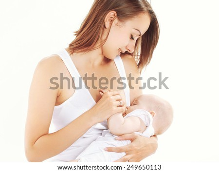 Mother feeding breast her baby - stock photo