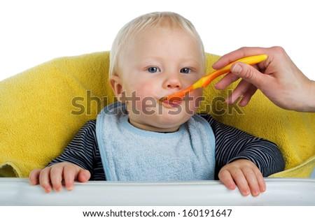 Mother feeding her baby boy, isolated - stock photo