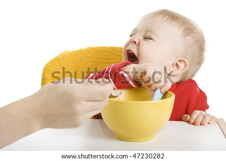 Mother feeding her fun baby - stock photo