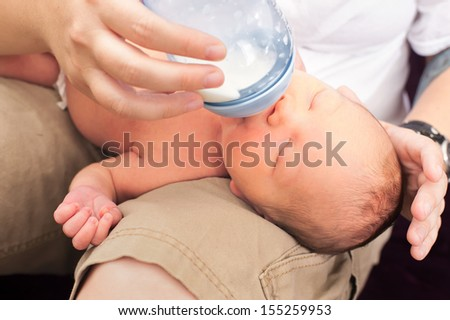 Mother feeding newborn baby - stock photo