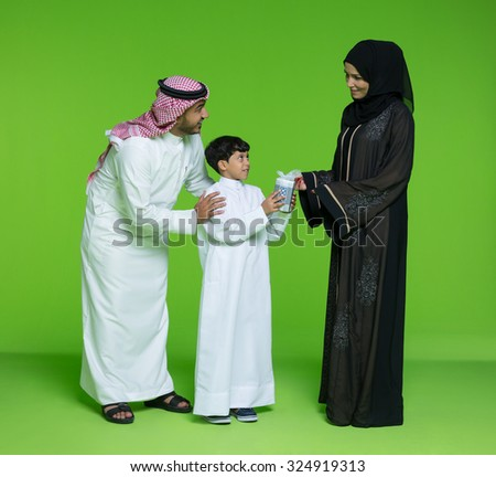 Mother giving gift to her son - stock photo