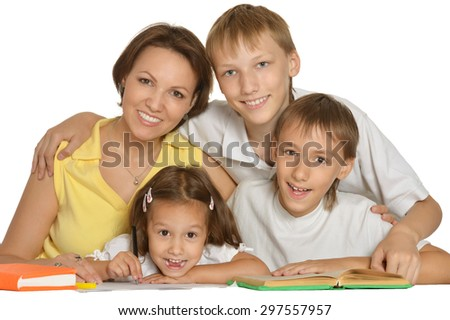 Mother help children do their homework on white background - stock photo