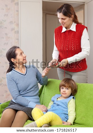 Mother hires nanny for her child at home - stock photo