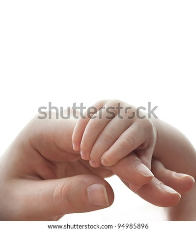 mother holding baby's hand closeup isolated on white - stock photo