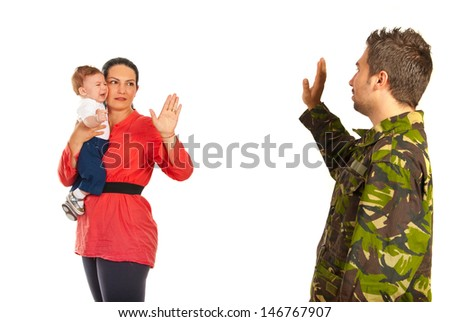 Mother holding crying baby and say goodbye to her military husband which goes back to the army isolated on white background - stock photo