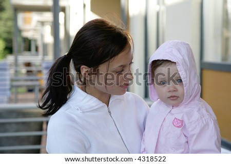mother holding cute baby girl - stock photo