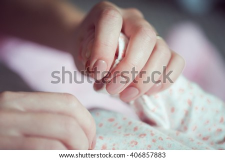 mother holding newborn hands - stock photo