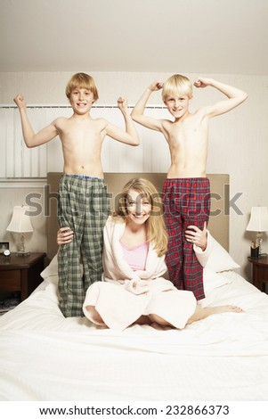 Mother Hugging Sons - stock photo
