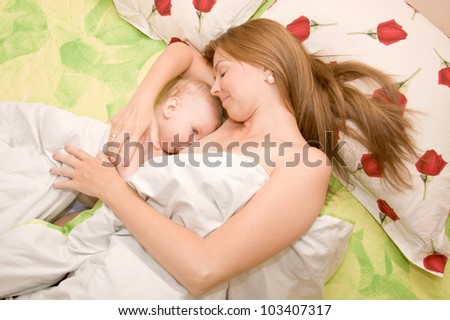 Mother is breast feeding baby boy. Mother's love. - stock photo