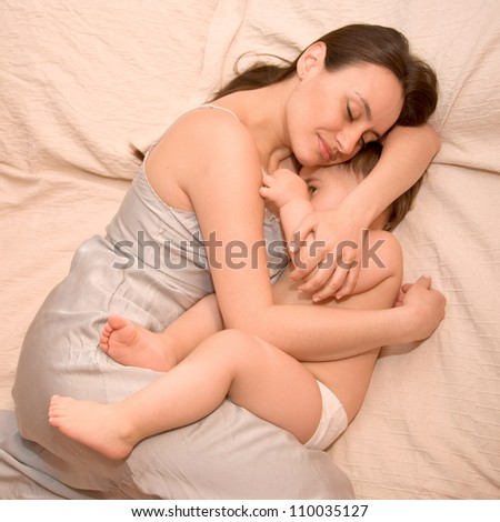 Mother is breast-feeding baby older than one year - stock photo