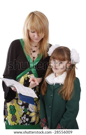 Mother is looking at school record book. Pupil is standing with woman. Isolated on white in studio. - stock photo