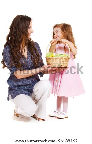 Mother, kid and spring basket, over white - stock photo