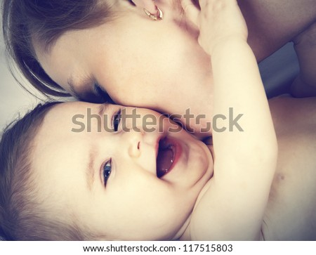 mother kissed her little baby, close-up - stock photo