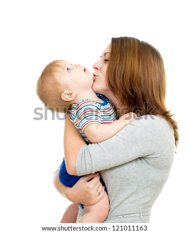mother kissing her baby boy isolated on white - stock photo