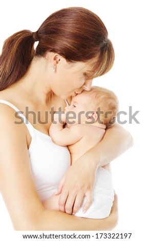 Mother kissing newborn baby holding in hand over white background  - stock photo