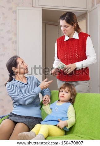 mother leaving baby with babysitter at home - stock photo