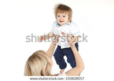 mother lifting up her happy one year old baby boy over white background. - stock photo