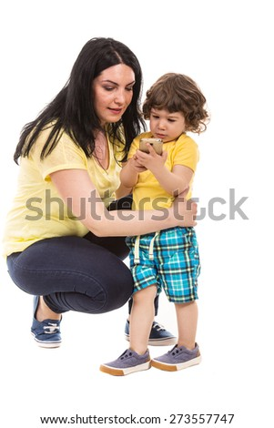 Mother looking to phone mobile while her son playing  on phone isolated on white background - stock photo