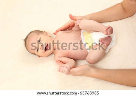 Mother massages her little daughter - stock photo