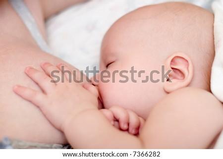 Mother nursing her new infant - stock photo