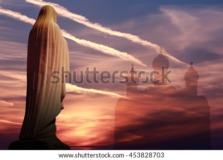 Mother of God over against dramatic sunset religious concept - stock photo