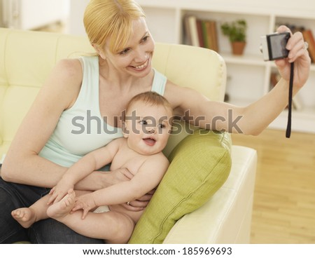 Mother Photographing Herself and Baby Boy - stock photo