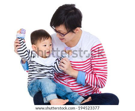 Mother play with son - stock photo