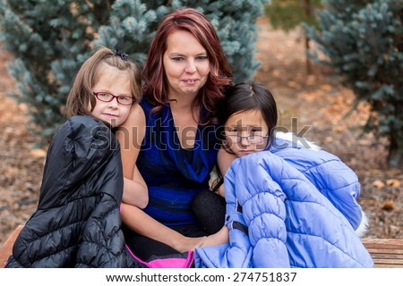 Mother playing with her young daughters at a park in Reno, Nevada, USA.   - stock photo