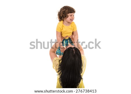 Mother raise her son over her head isolated on whie background - stock photo