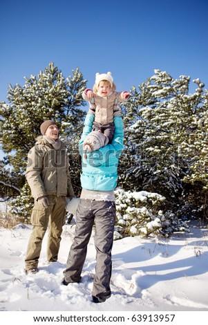 Mother raising kid up high - stock photo