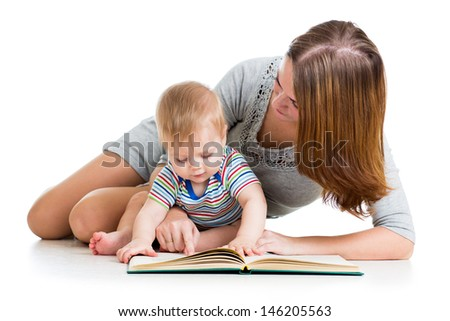 mother reading a book to baby boy - stock photo