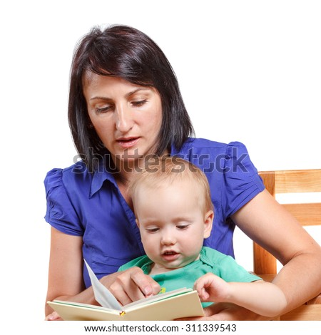 Mother reading a book to his mischievous kid. Studio isolated on white - stock photo