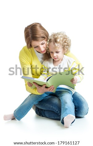 mother reading a book to kid girl - stock photo