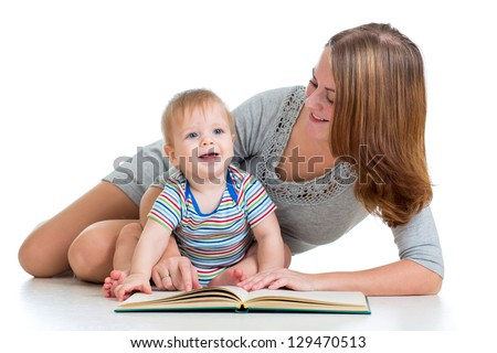 Mother reading book to son - stock photo