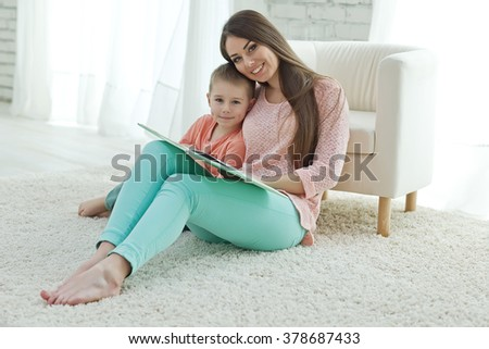 Mother reading with child - stock photo