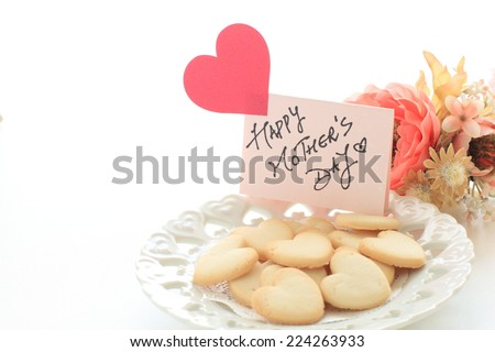 Mother's day background, sweet heart shaped cookie and greeting card - stock photo